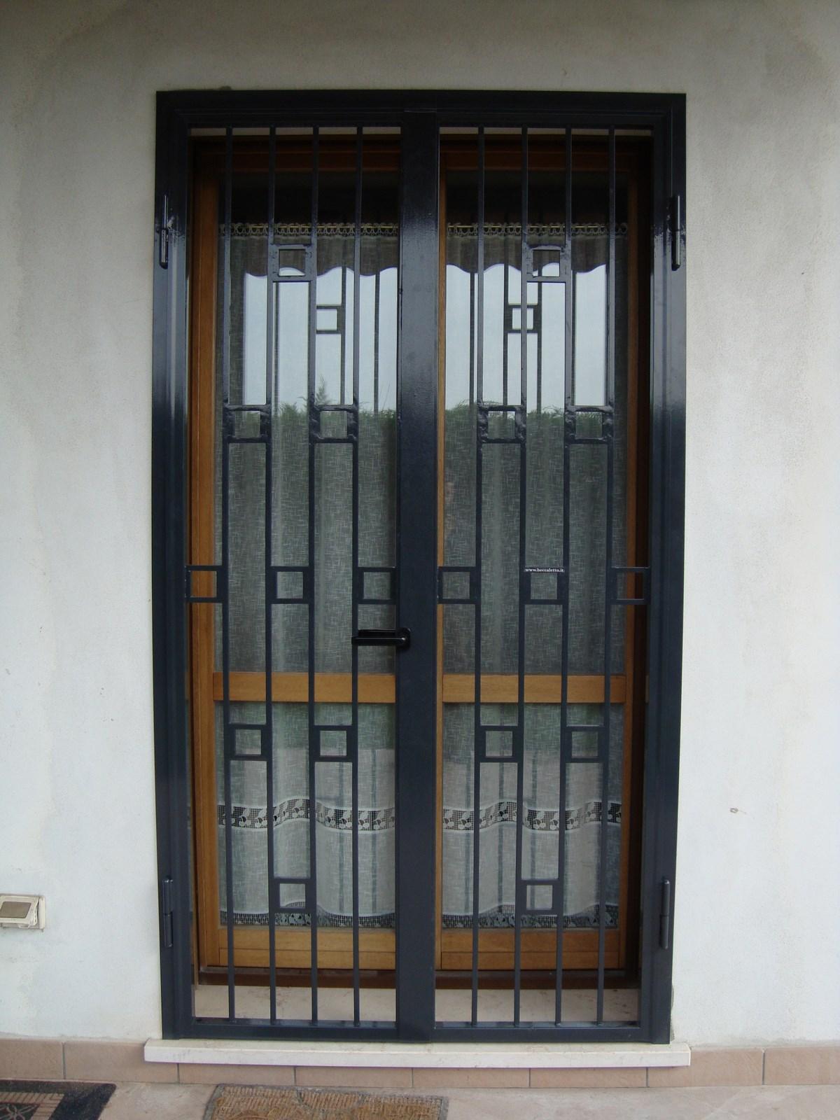 Porte inferriate in ferro battuto - Ferro battuto porta ...