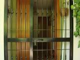 P06 Porta inferriata a due ante in stile classico