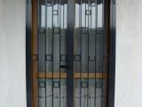 P09 Porta inferriata a due ante in stile moderno