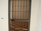 P10 Porta inferriata ad un anta in stile classico